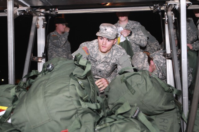 soldiers with duffel bags